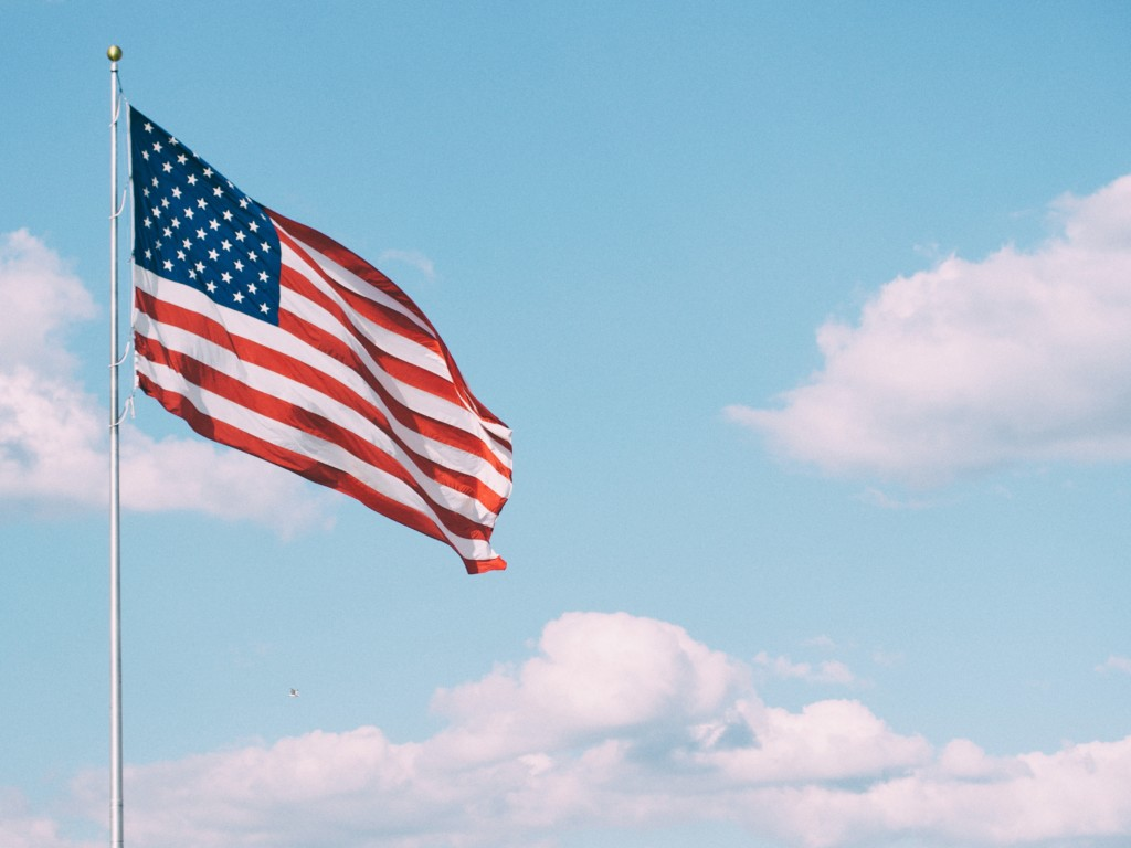 American flag against a blue sky Providence Moms Blog