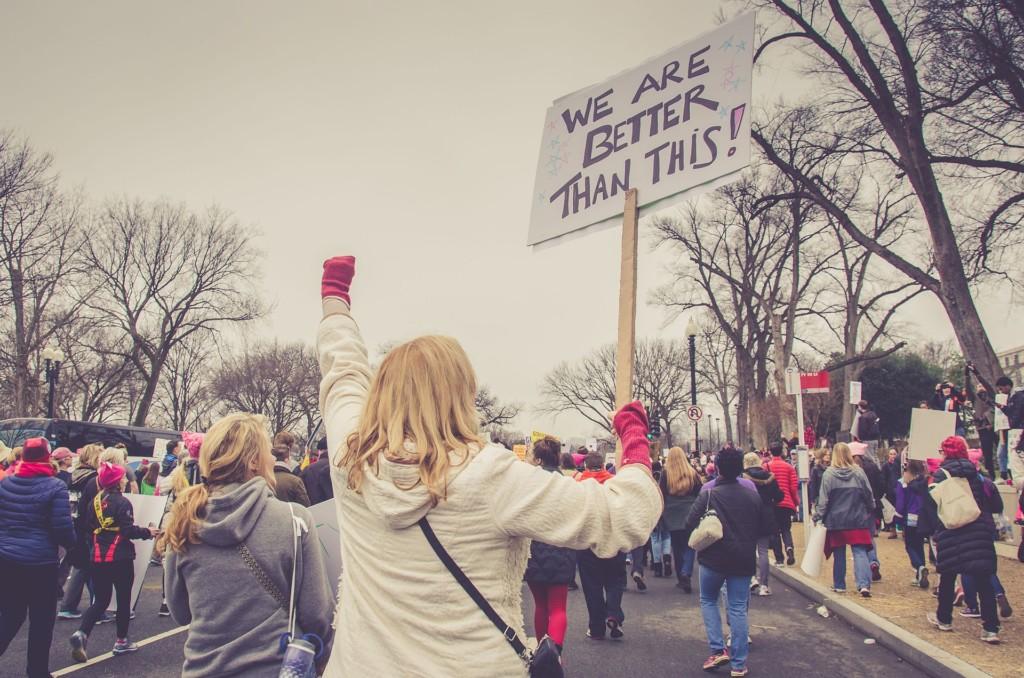 woman and crowd protesting gun violence Providence Moms Blog
