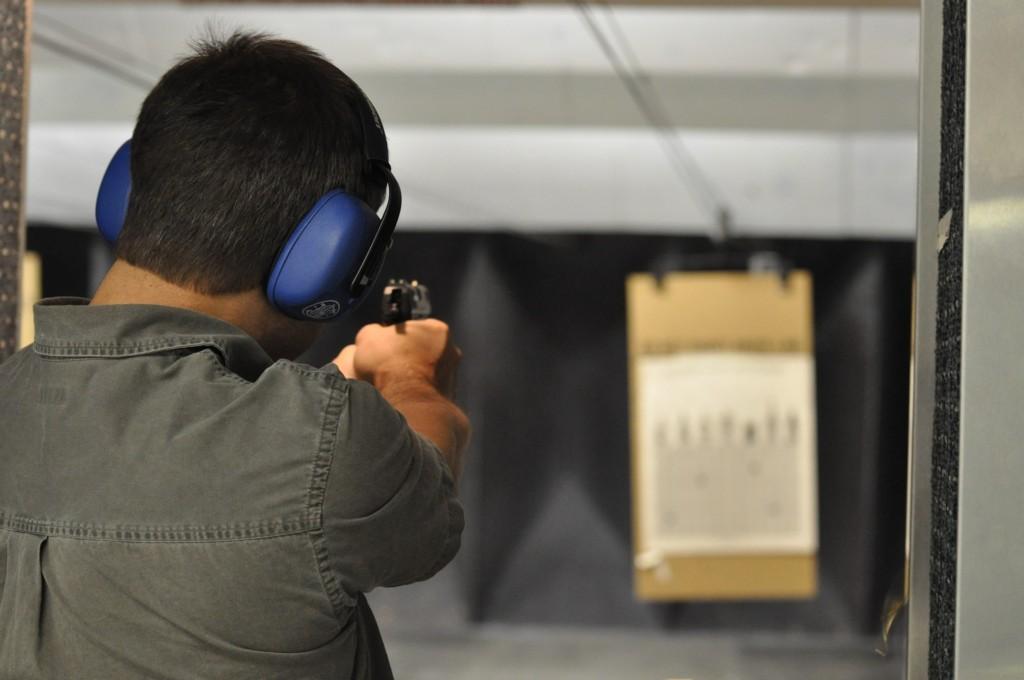 man shooting gun at target Providence Moms Blog