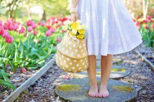 woman holding bag of flowers Providence Moms Blog