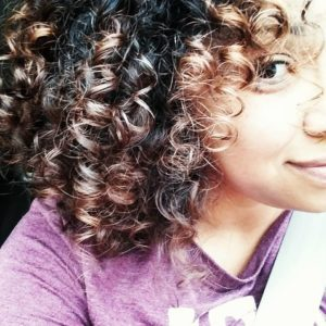 woman with curly hair Providence Moms Blog