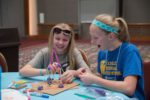 two girls designing engineering project for STEM class at SWENext DesignLab Providence Moms Blog