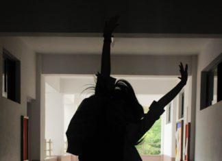 girl jumping up in school hallway Providence Moms Blog