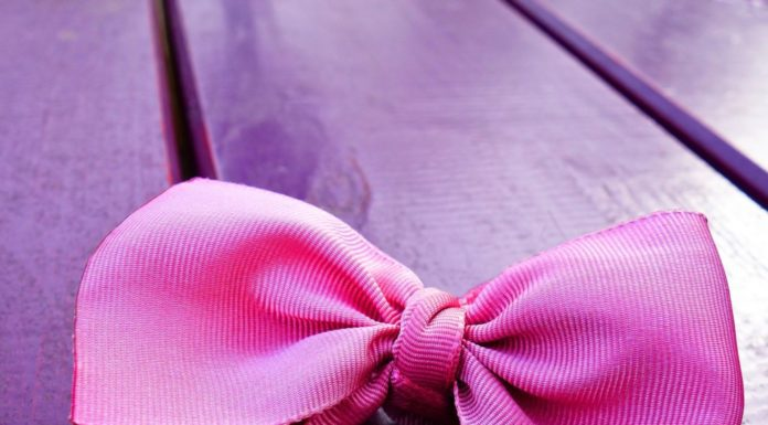 Pink bow on purple table in providence Moms Blog organizer article