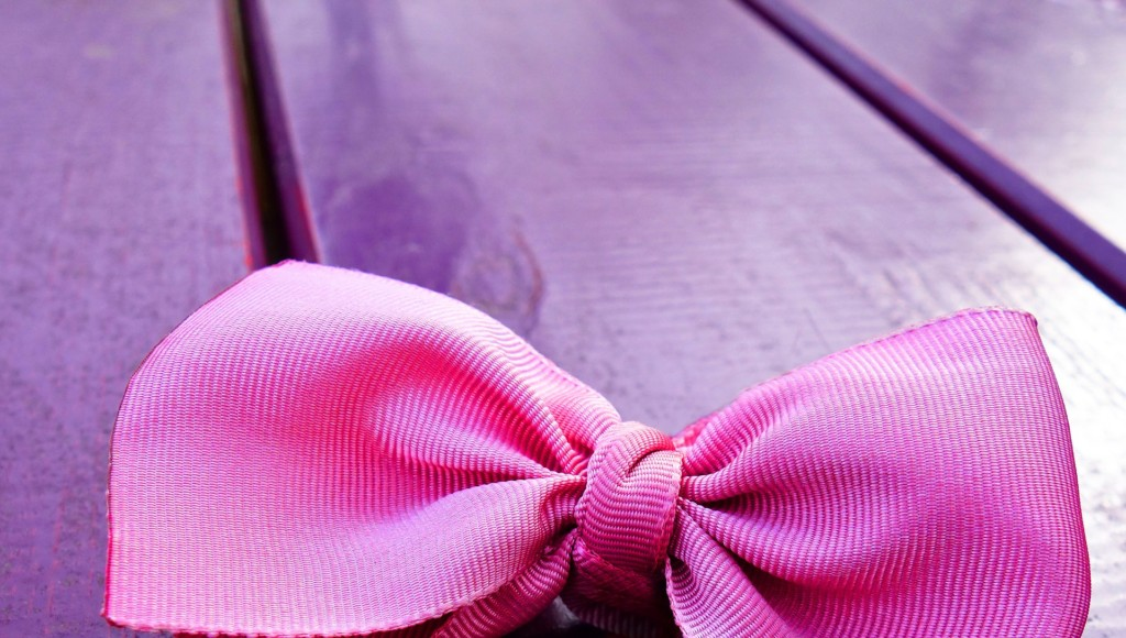 Pink Bow on Purple Background in Providence Rhode Island Moms Blog Organizing Blog Post