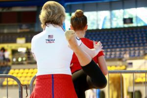 gymnastics coach with young gymnast Providence Moms Blog