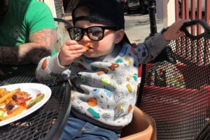 toddler boy sitting at table Providence Moms Blog