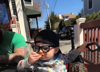 toddler boy sitting at table Providence Moms Blog