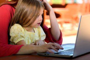 little girl sitting on mother's lap Providence Moms Blog