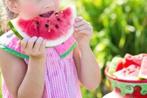 girl eating slice of watermelon Providence Moms Blog