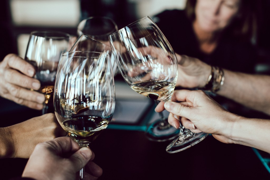 clinking wine glasses Providence Moms Blog