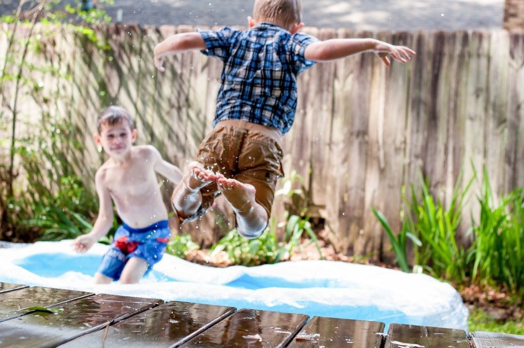 boys jumping into kiddie pool Providence Moms Blog