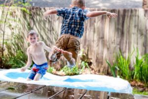 boys jumping into kiddie pool Providence Moms Blog