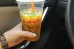 Holding Dunkin' Donuts Iced Coffee in Car Providence Moms Blog