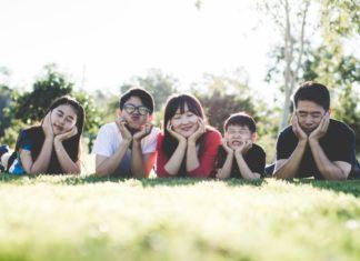 family smiling Providence Moms Blog