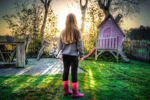 girl backyard in rain boots Providence Moms Blog