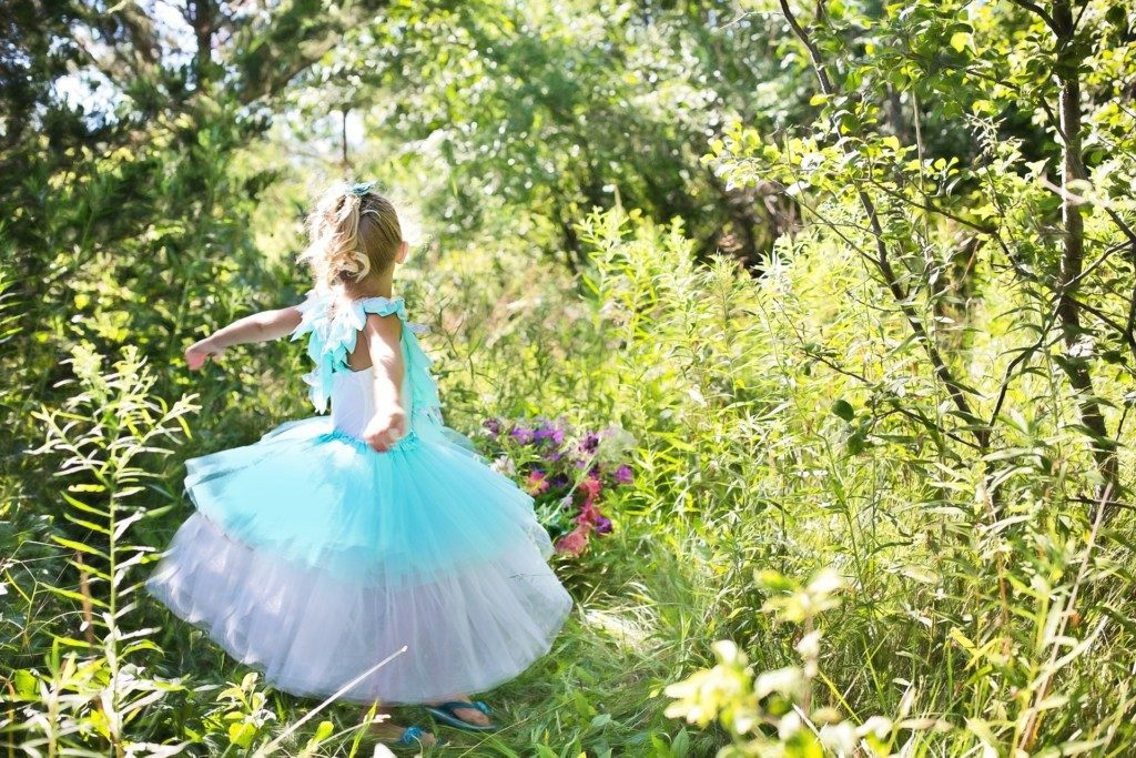 girl pretending to be princess in the woods Providence Moms Blog