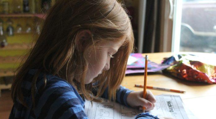 girl doing homework Providence Moms Blog