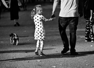 daughter holding hands with father Providence Moms Blog