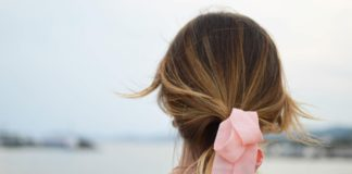 woman wearing pink ribbon in her hair