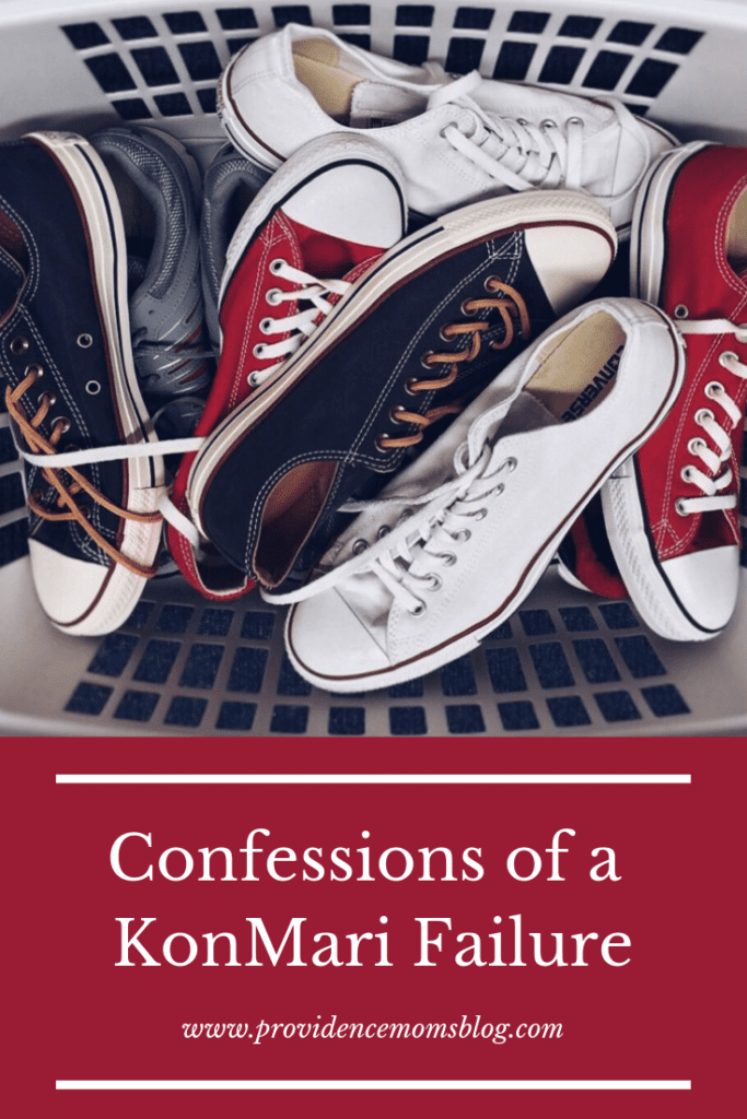 """Picture of many pairs of shoes in a laundry basket with words """"Confessions of a KonMari Failure"""" www.providencemomsblog.com"""