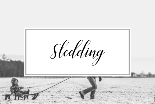 Picture of snowy background with a child being pulled on a sled and the words Sledding. Activities and things to do in Providence Rhode Island in the Winter