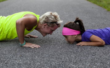 woman and child doing push ups