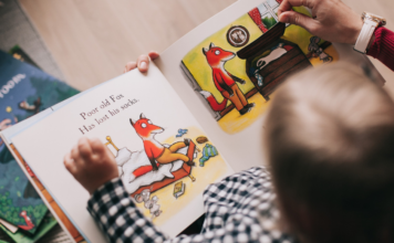 small child reading picture book