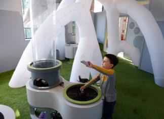 boy playing in creativity initiative exhibit providence children's museum