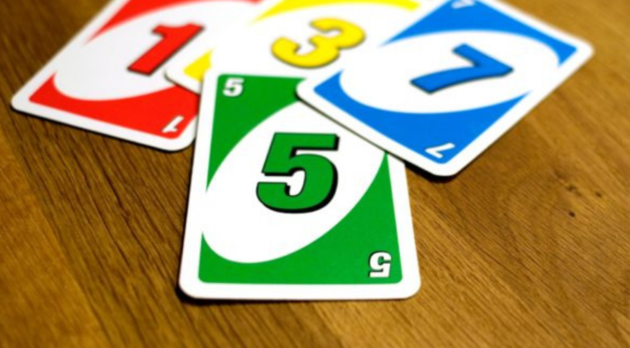 red, blue, green, and yellow uno cards: My Family Is Competitive