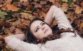 woman in fall leaves