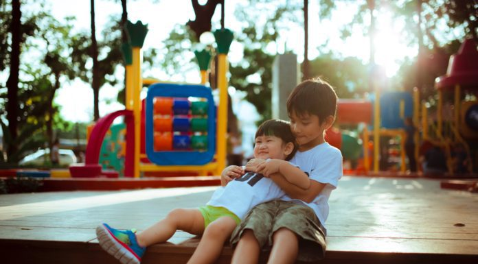 2 children playing on a playground