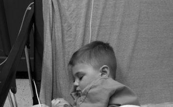 child in hospital bed after febrile seizure