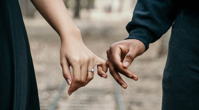 white woman and black man holding hands