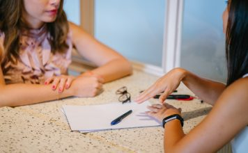 two women in a meeting regarding infertility