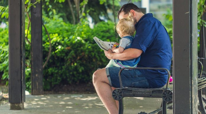 man and child reading outside | Springtime Books | providence mom