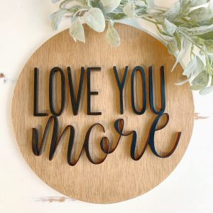 scrolled sign with words love you more