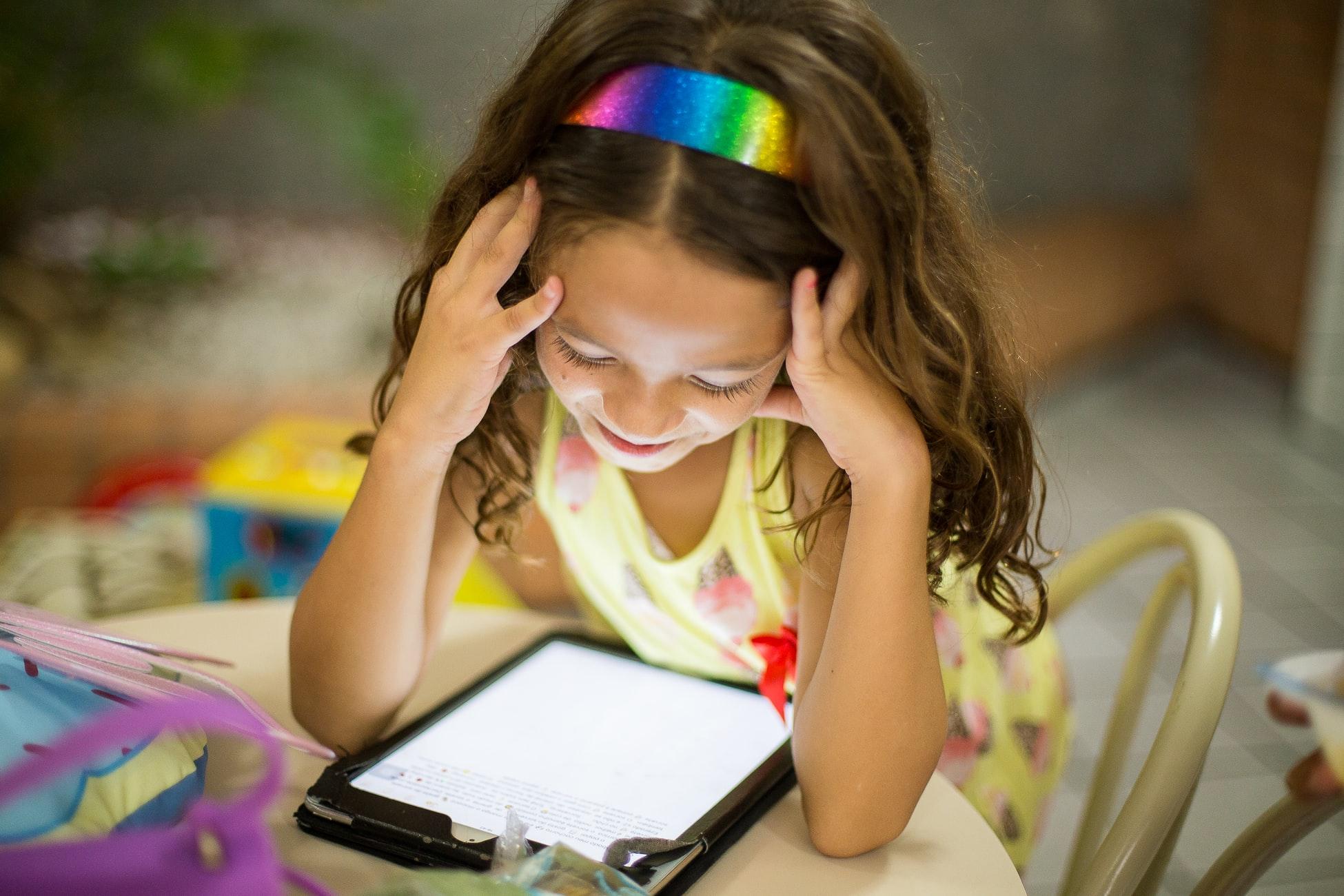 girl attending virtual story time